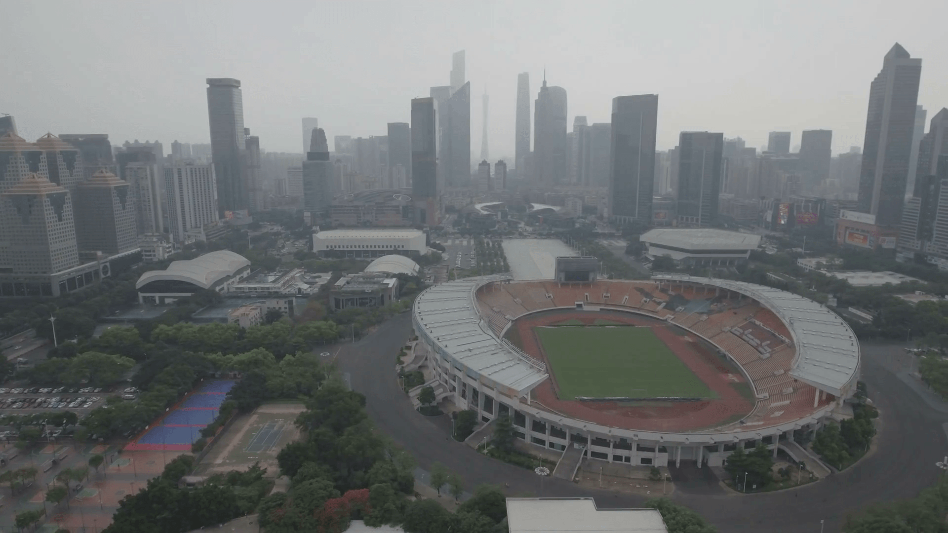 Panning aerial view of the stadium of the Guangzhou Evergrande ...