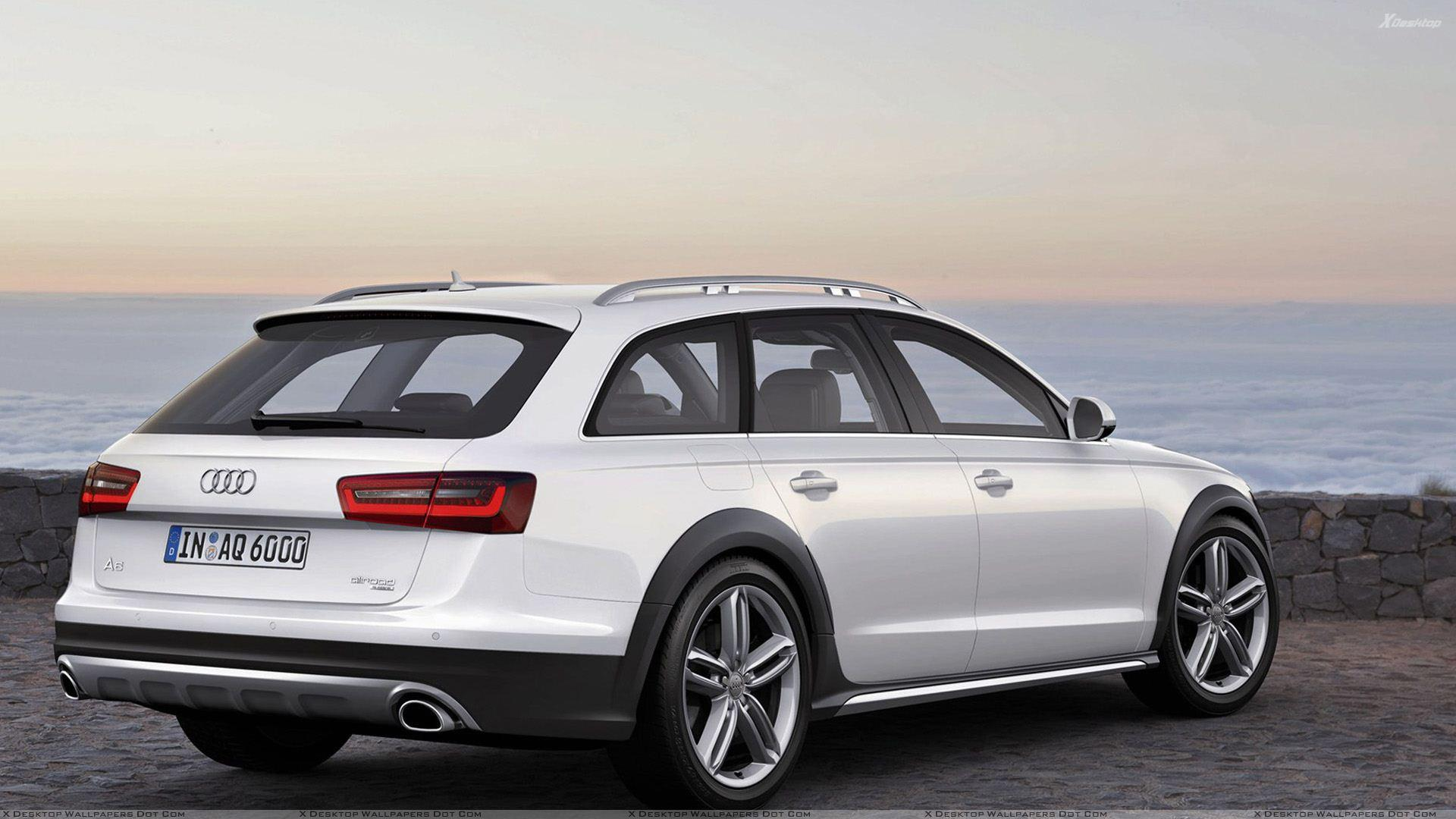 Back Side Pose Of 2013 Audi A6 Allroad In White Near Sea Side Wallpaper