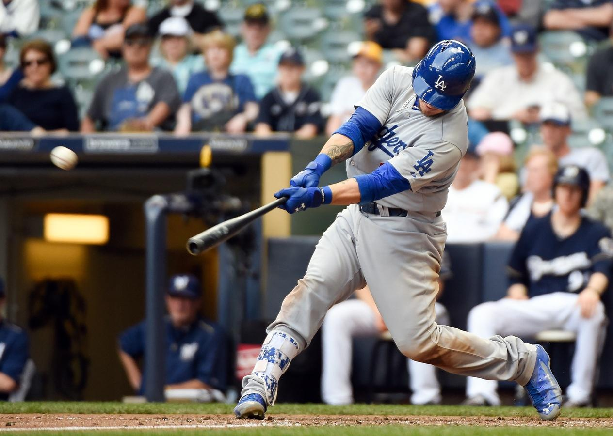 Yasmani Grandal drives home eight, just 11th catcher to do it