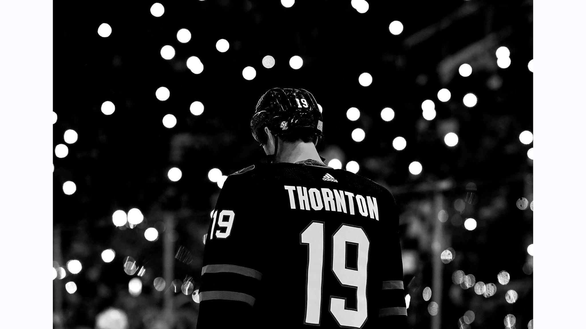 Joe Thornton of the San Jose Sharks stands for a moment of