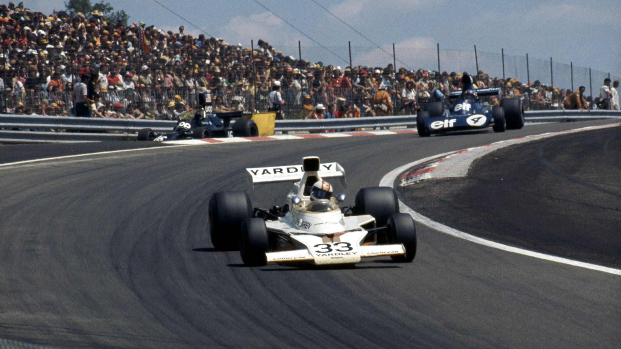 Mike Hailwood, McLaren-Ford M23 followed by Patrick Depailler ...