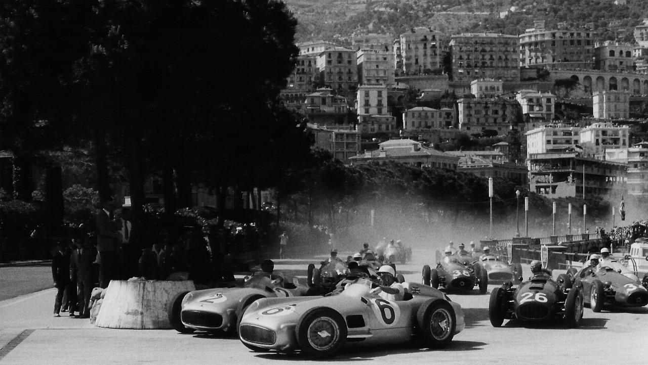 autocar: Stirling Moss and Fangio in the 1955 Monaco Grand Prix