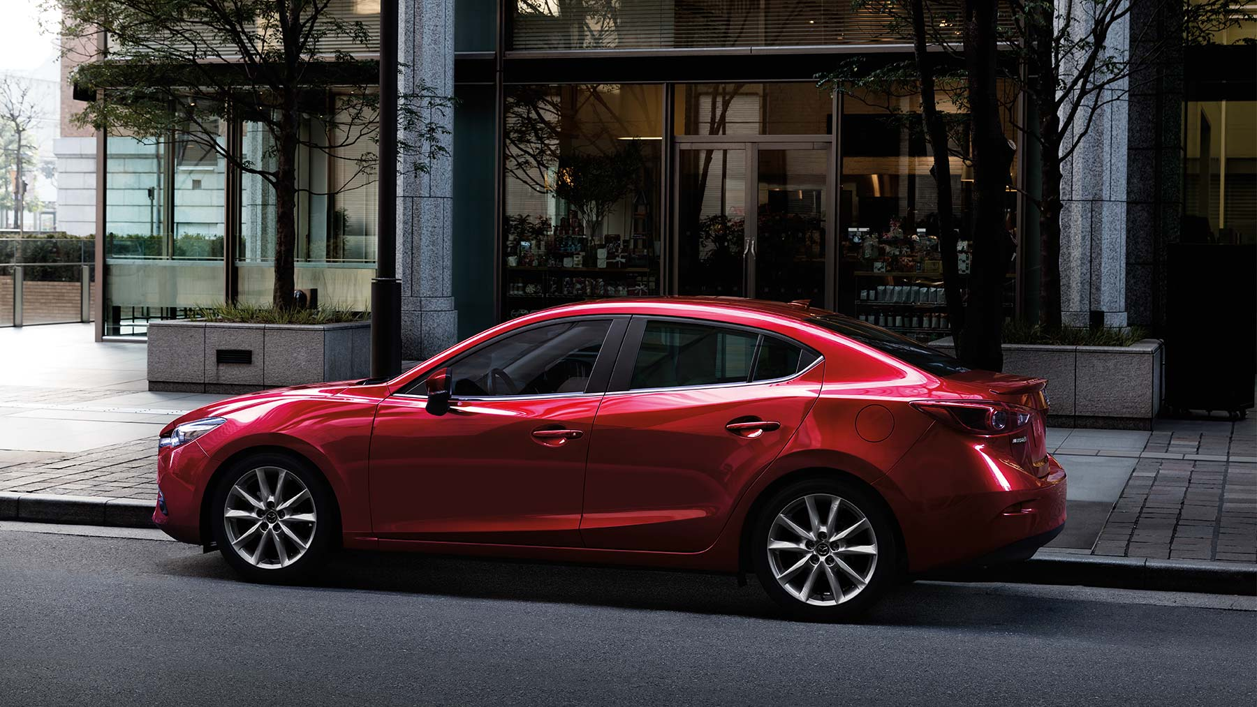 2019 Mazda 3 red color on road in city 4k hd wallpapers