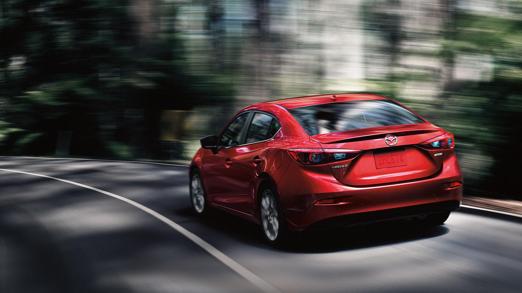 2019 Mazda 3 red color rear back side view on highway in forest 4k