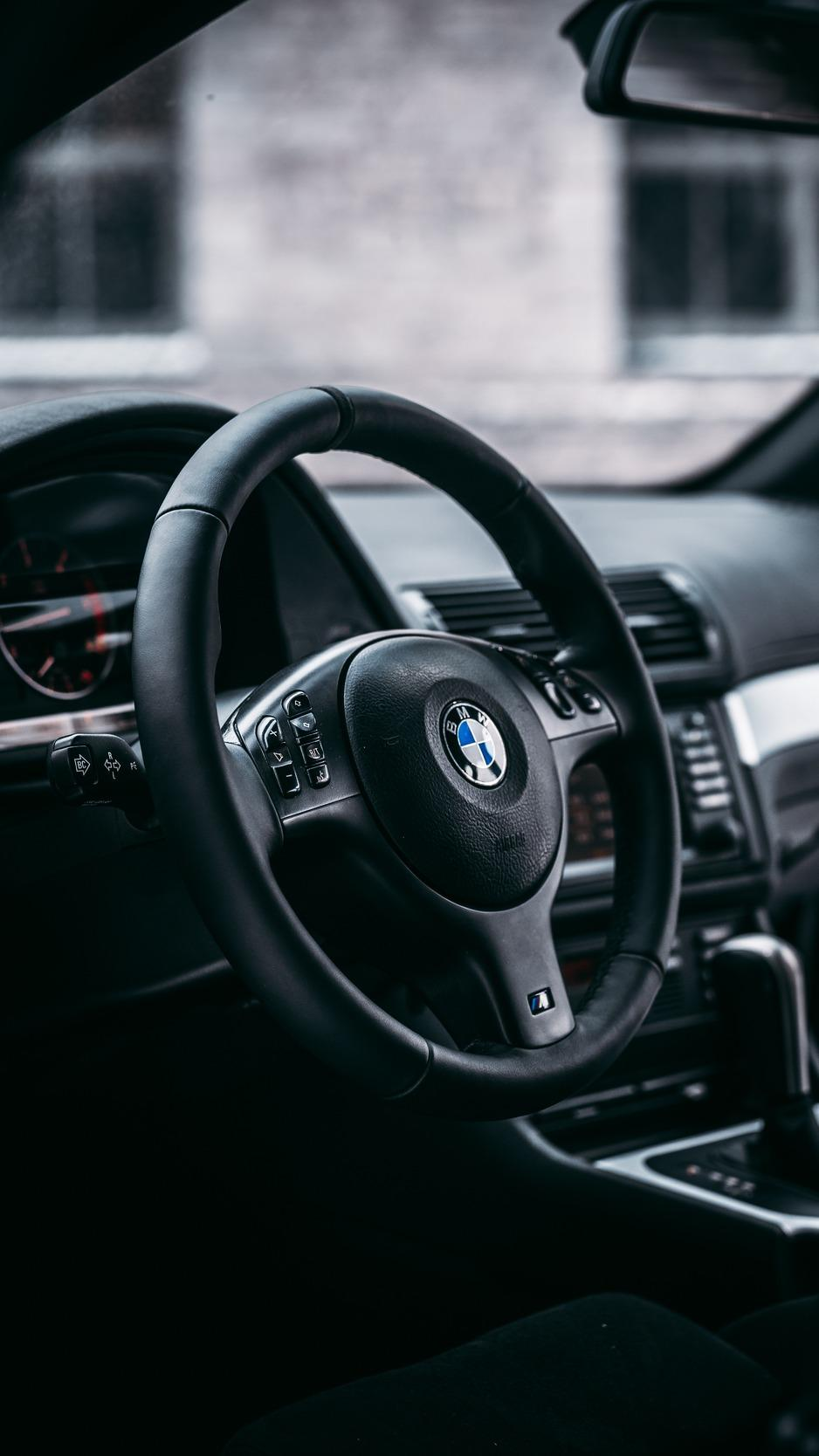 Download wallpapers 938x1668 bmw, steering wheel, car, car interior