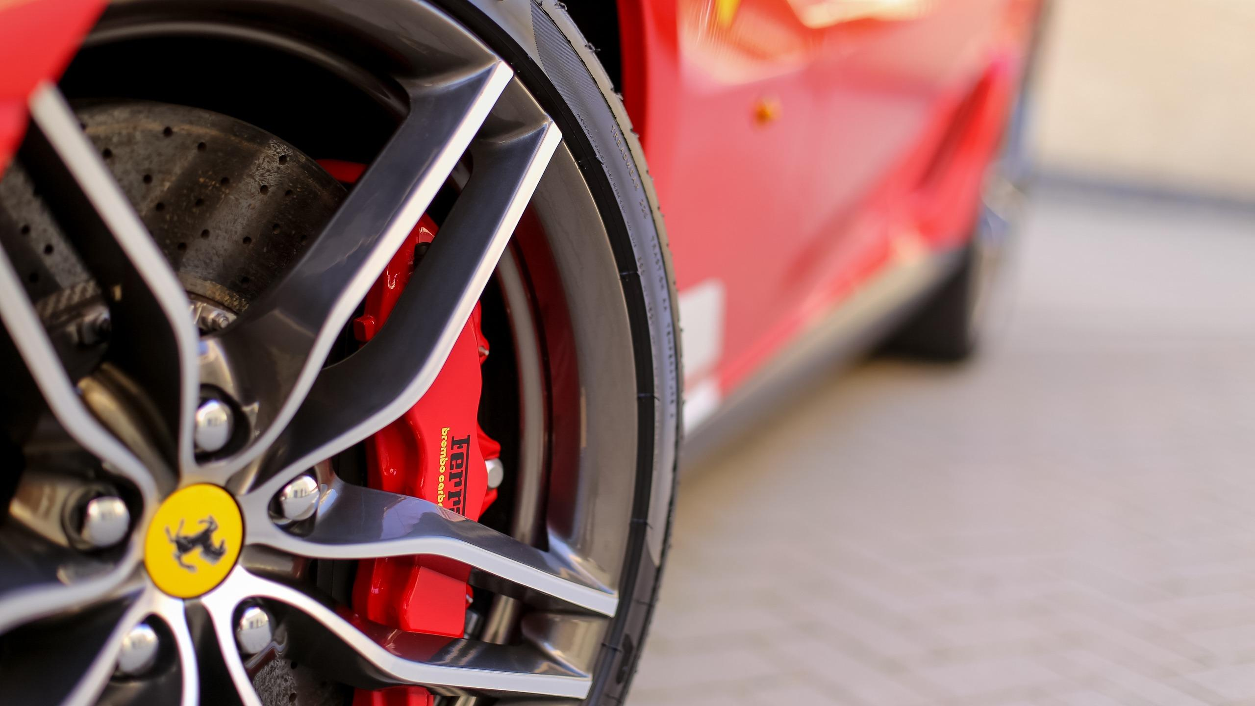 Download wallpapers 2560x1440 ferrari, tire, wheel, logo widescreen
