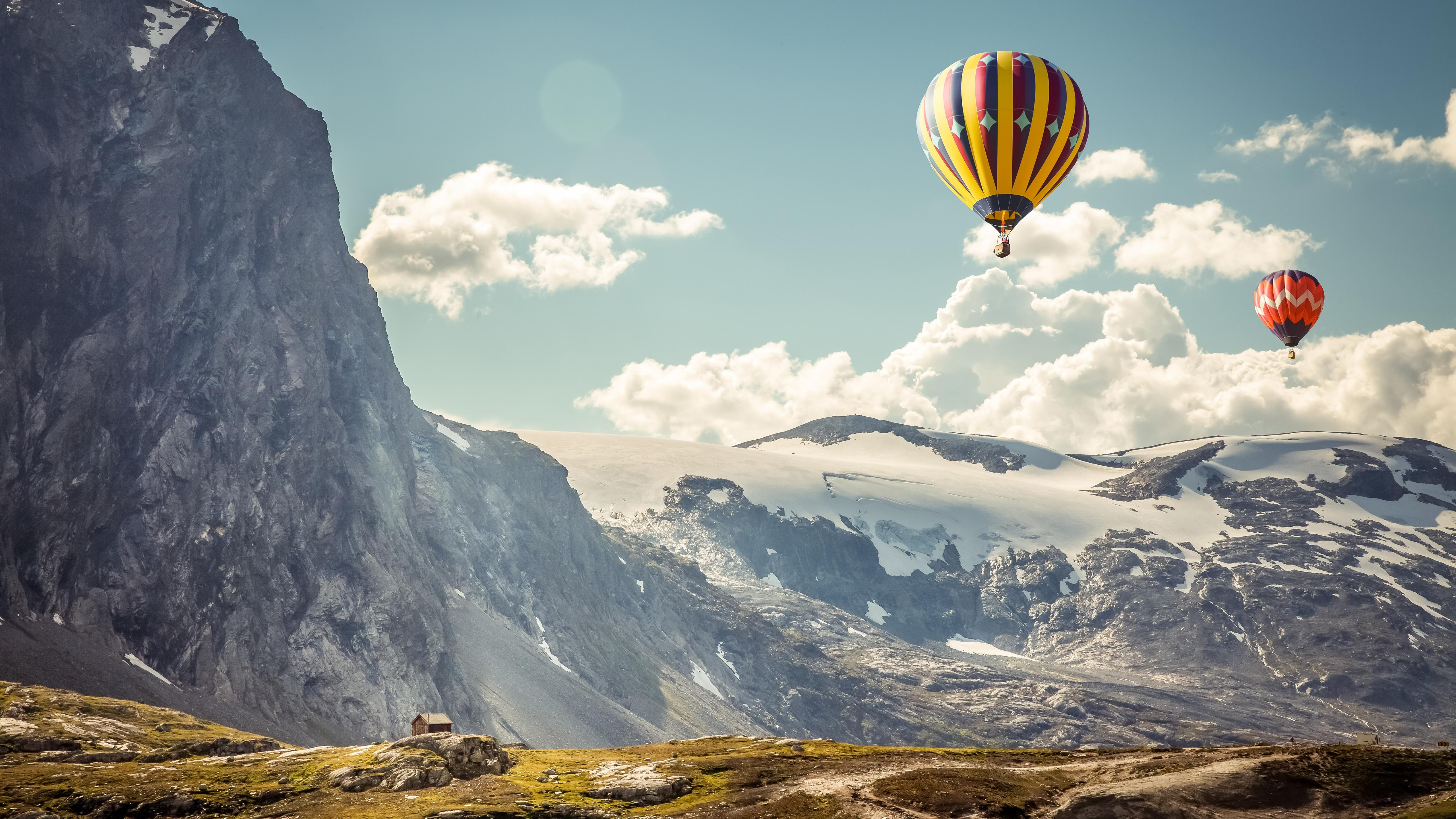 Download 5120x2880 Hot Air Balloon, Scenic, Mountain, Clouds, House