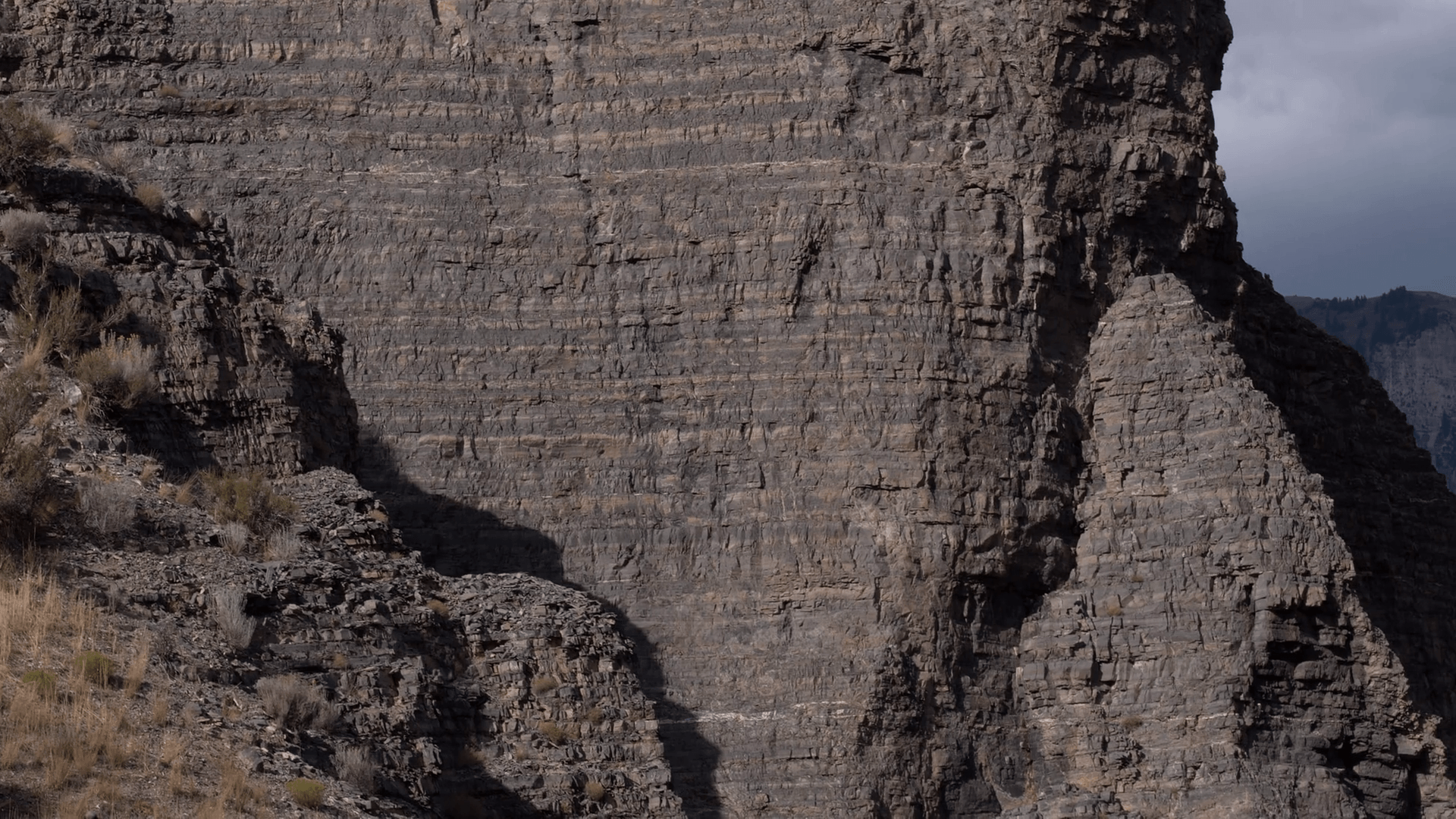 Aerial panning view of rocky cliff face revealing Mountain from Provo Canyon, Utah. Stock Video Footage